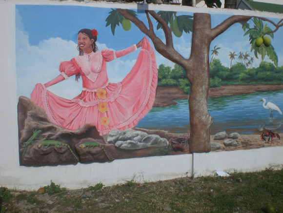 Painting of a Raizal woman on a wall of a Colombian Island near San Andres.